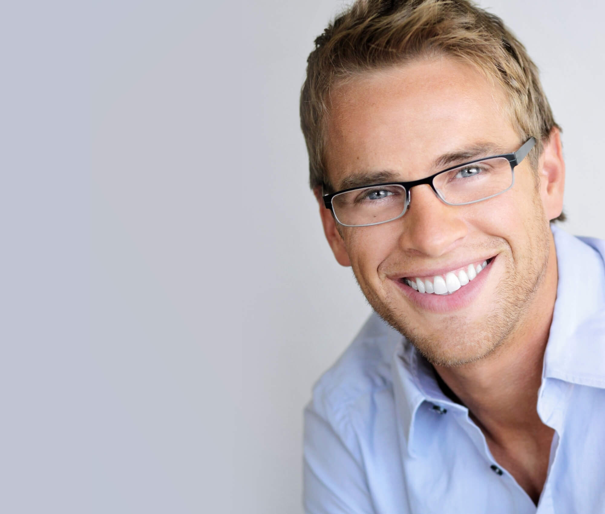 man smiling after Invisalign Consultation